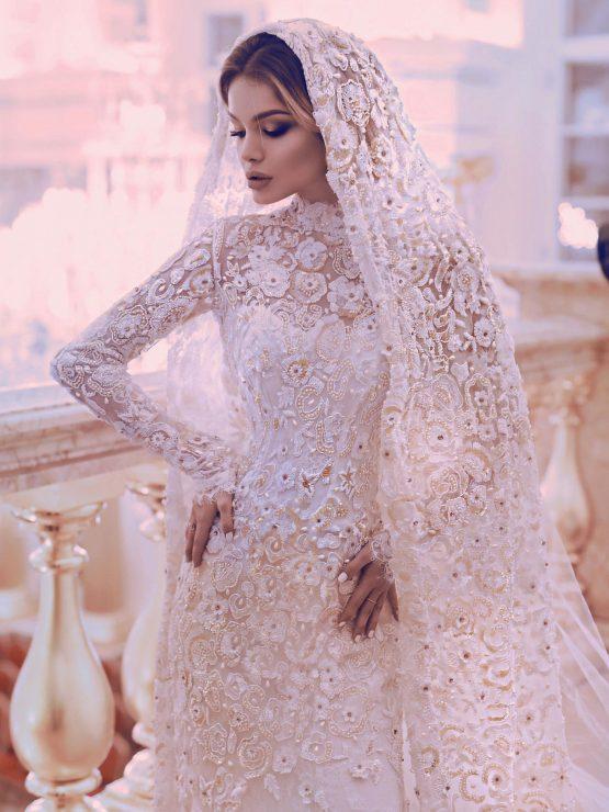 Кружевное закрытое свадебное платье с рукавами